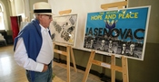 Branko Lustig looking at the posters