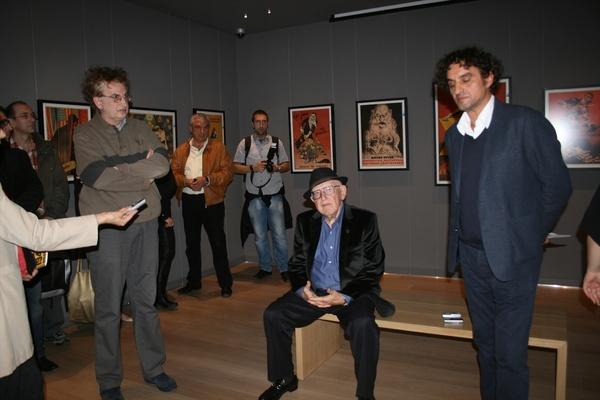 Slobodan Blagojević, Branko Lustig and Tarik Samarah at the opening of the exhibition